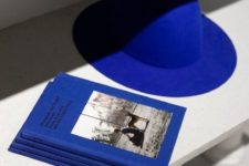 14 a classic blue hat makes a bold colorful statement especially with a neutral outfit