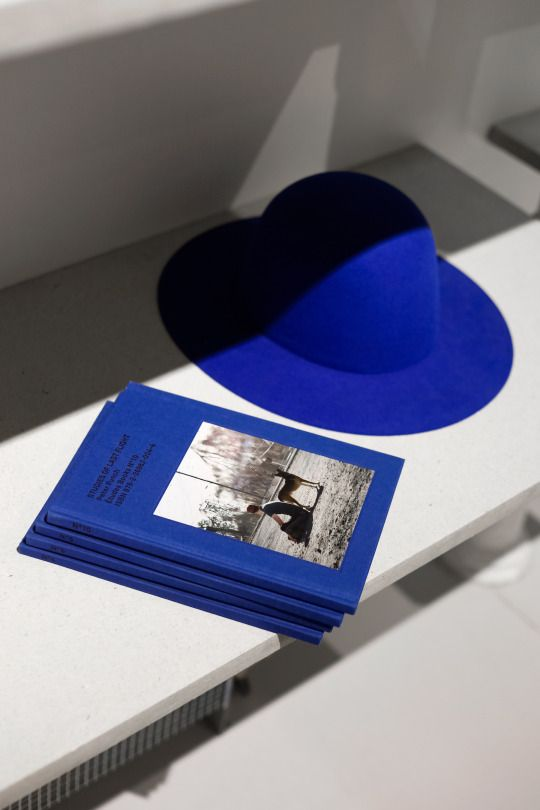 a classic blue hat makes a bold colorful statement especially with a neutral outfit