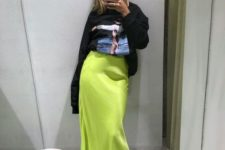 14 an oversized black sweatshirt, a neon green midi, neon green shoes for a hot spring look