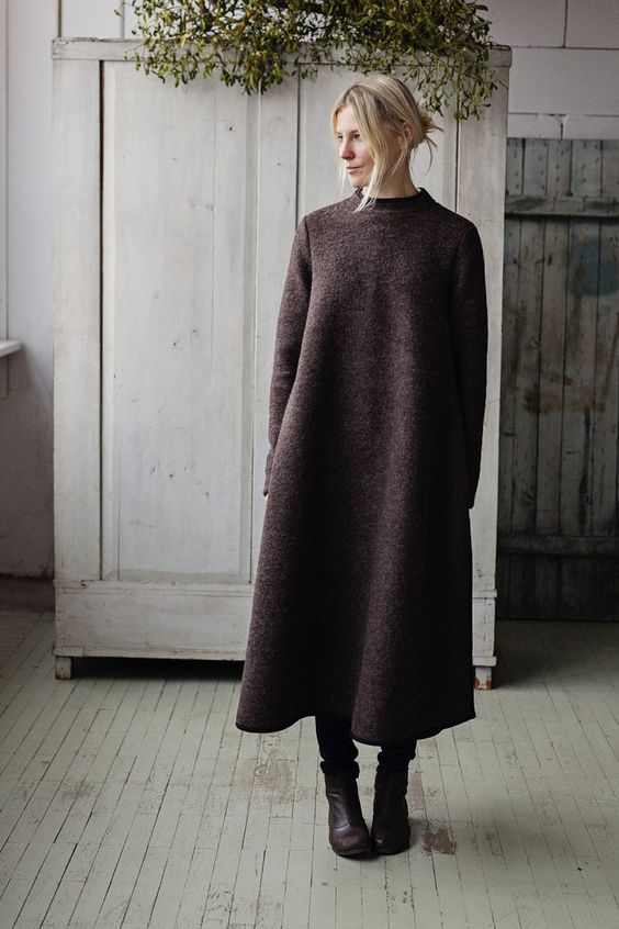 an oversized brown minimalist A-line sweater dress plus matching brown boots for winter