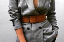 14 black jeans, a grey checked oversized blazer and an amber wide waist belt is a bold and chic idea