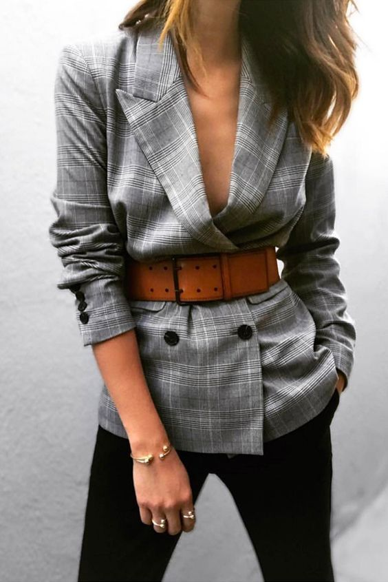 black jeans, a grey checked oversized blazer and an amber wide waist belt is a bold and chic idea
