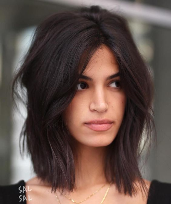 a fun medium haircut with dark chocolate color and much texture for a fresh and trendy look
