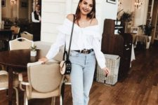 15 a stylish look with a white off the shoulder ruffle blouse, high waisted jeans, black booties and a two tone bag