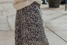 15 an oversized sweater is paired with a printed midi skirt that shows off the silhouette