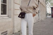 15 an oversized sweater, white jeans with a raw hem, neutral booties and a black bag