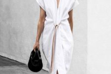 16 a white minimalist knot midi dress with a beige belt, cap sleeves and a black bag for summer
