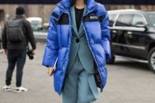 16 an oversized classic blue puff coat is a stylish touch of color to the outfit, and you'll feel comfy in it