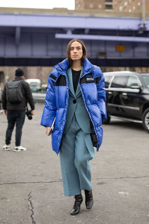 an oversized classic blue puff coat is a stylish touch of color to the outfit, and you'll feel comfy in it