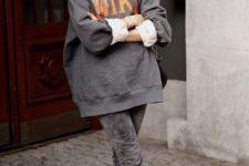16 an oversized grey sweatshirt, grey jeans, black slipper mules for a winter feel