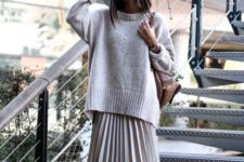 16 an oversized neutral sweater paired with a matching pleated midi plus sneakers are a cool idea to go for