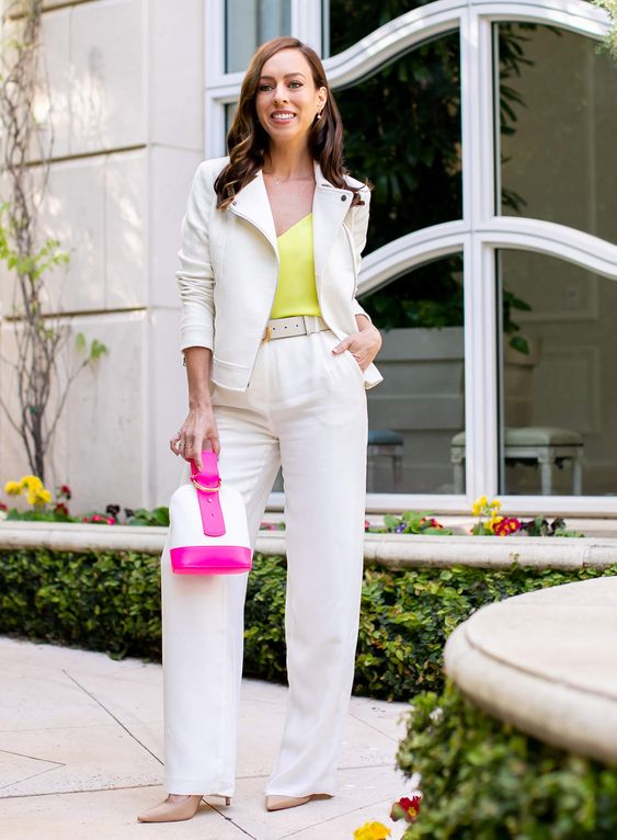 white pants, a white jacket, a neon yellow top and a neon accented bag plus nude heels for work