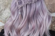 20 a romantic lilac half up hairstyle with a braided halo and waves is a chic boho -inspired idea