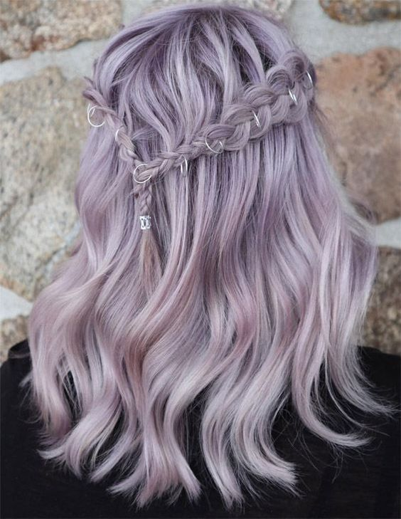 a romantic lilac half up hairstyle with a braided halo and waves is a chic boho -inspired idea