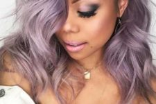 25 lilac hair with a darker root is another cool and trendy idea to try, feel free to rock waves to give more volume to your hair