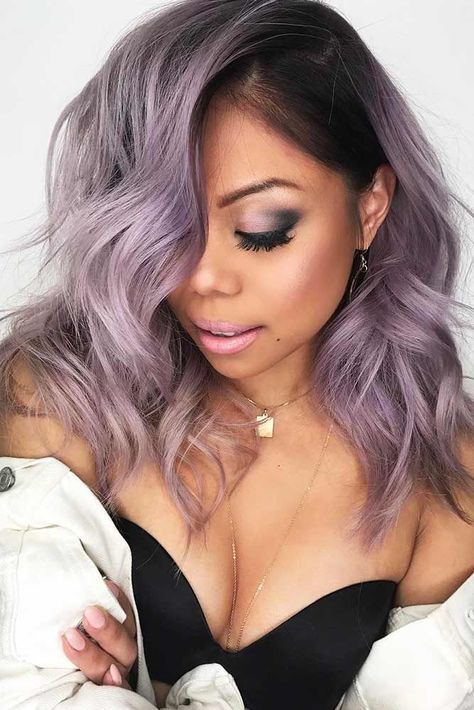 lilac hair with a darker root is another cool and trendy idea to try, feel free to rock waves to give more volume to your hair