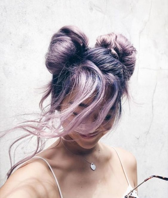 beautiful lilac hair done into a fancy updo with two knots and some long wavy locks down