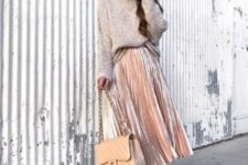 With beige long sweater, beige pumps and beige bag