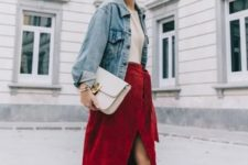 With beige shirt, denim jacket, white clutch and printed pumps