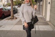 With beige sweater, black leather mini skirt and mini bag