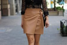 With beige wrapped mini skirt, black bag and black patent leather boots