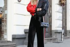 With black and red jacket, mini bag and red ankle boots