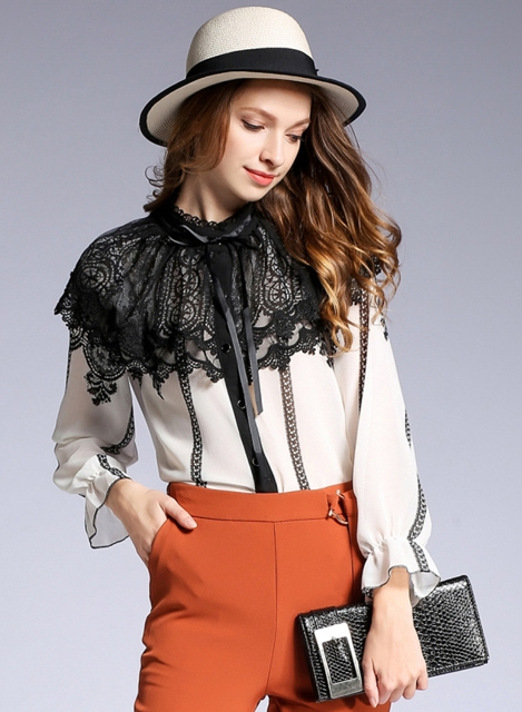 With black and white hat, clutch and orange trousers