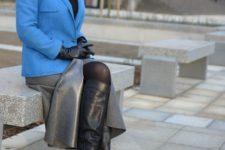 With black cap, blue blazer, gray midi skirt and black high boots