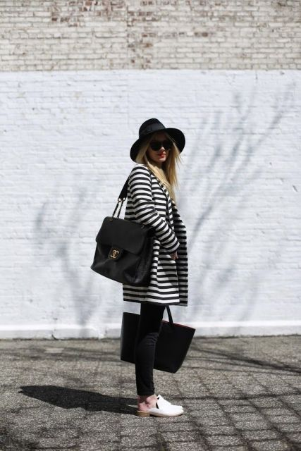With black hat, black tote bag, skinny pants and mules
