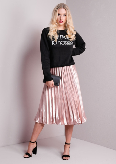 With black labeled sweatshirt, black clutch and ankle strap shoes
