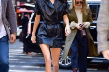 With black leather belted mini dress
