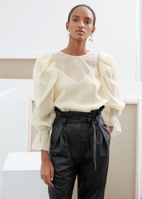 With black leather belted trousers