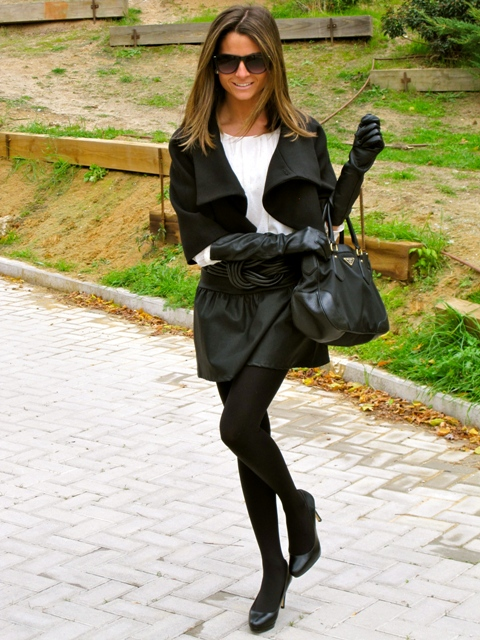 With black mini skirt, white blouse, jacket, bag and pumps