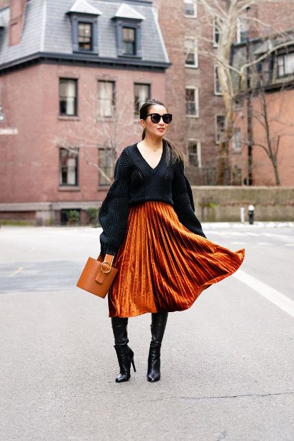 With black oversized sweater, brown leather bag and black leather over the knee boots