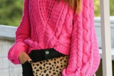 With black pants and leopard clutch