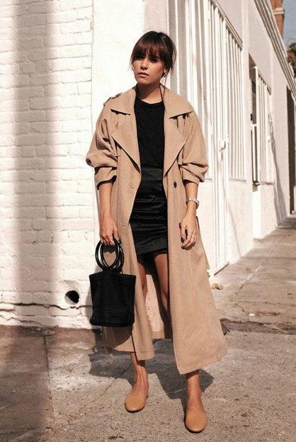 With black shirt, black mini skirt, beige flats and black bag