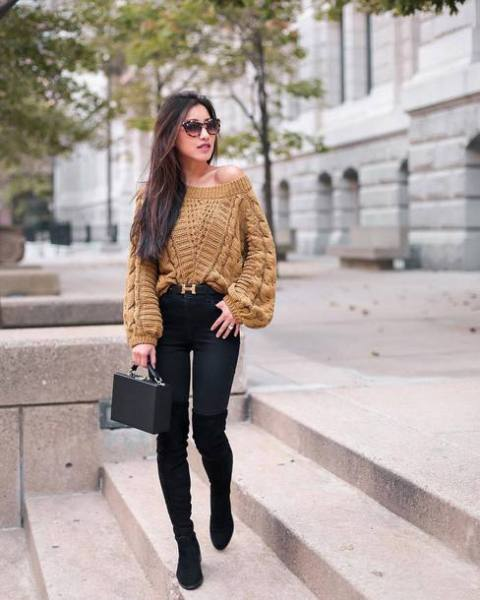 With black skinny pants, black bag and suede over the knee boots