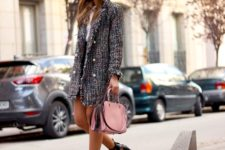With black skirt, white shirt, pink bag and cutout shoes