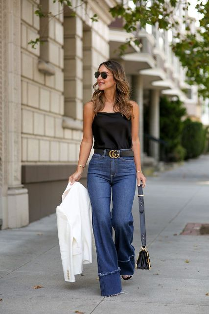 With black top, black belt, mini bag, high heels and white blazer