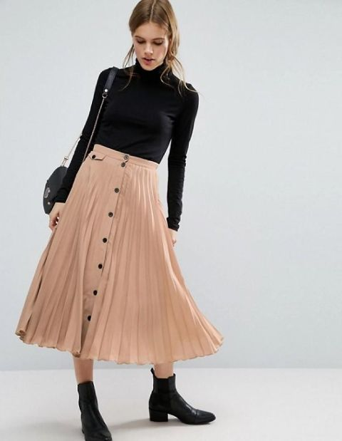 With black turtleneck, chain strap bag and black ankle boots