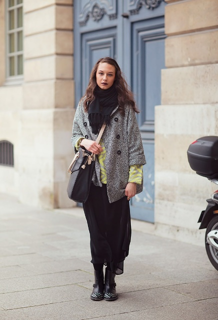 With boots, yellow sweater, black airy maxi skirt and bag
