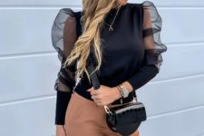 With brown pants and black crossbody bag