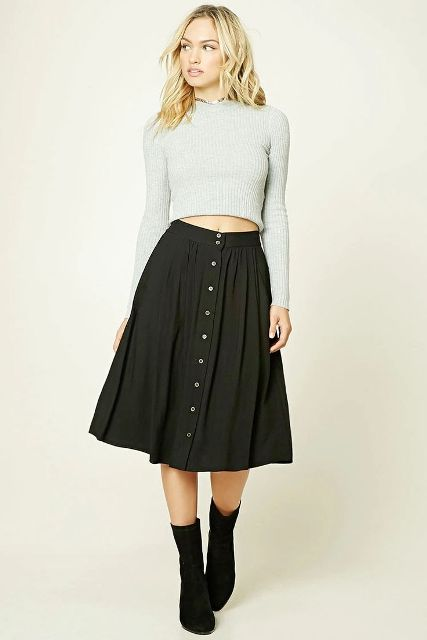 With cropped sweater and black mid calf boots