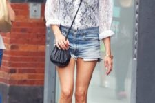 With denim shorts, black crossbody bag and platform lace up boots