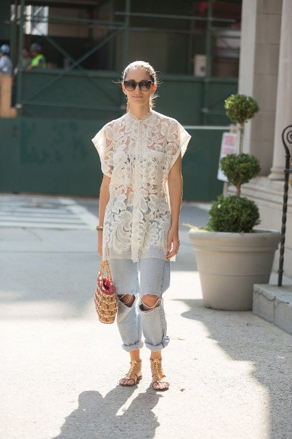 With distressed cuffed jeans, sunglasses, bag and lace up sandals
