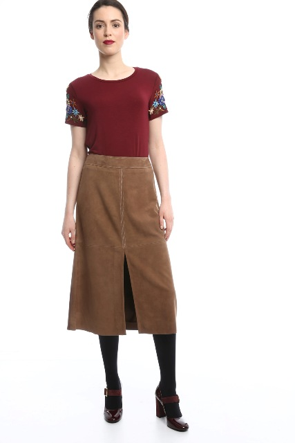With floral t-shirt, black tights and brown patent leather shoes