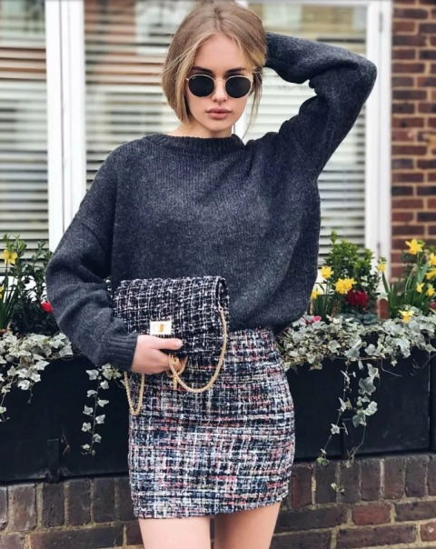 With gray loose sweater and tweed mini skirt