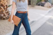 With gray t-shirt, brown belt and brown clutch
