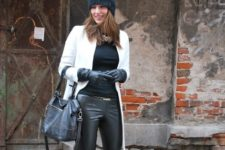 With hat, black shirt, leather trousers, high heeled boots and bag