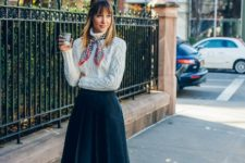 With knee-length skirt, printed scarf and black shoes